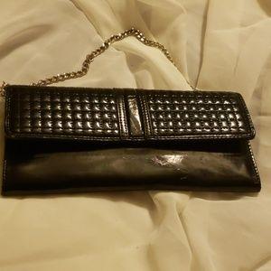 New. Black clutch purse